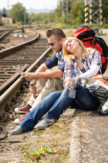 Woman resting on man's shoulder backpack travel