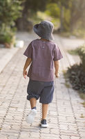 Rear view of a little cute boy walking