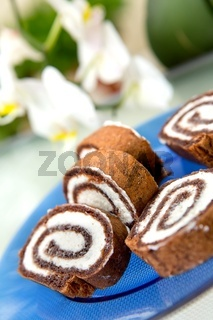 Chocolate roulade with orchid in background