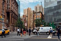 People crossing street in East Village in New York