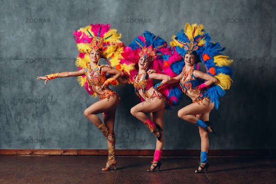 Three Woman in cabaret costume with colorful feathers plumage