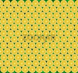 Texture of lemon slices. Citrus pattern. Sour background