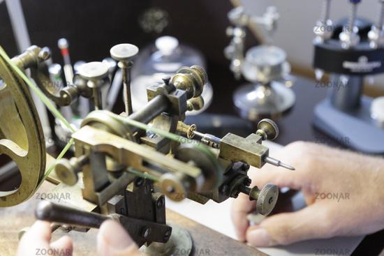 Watchmaker, clockmaker, horologist,