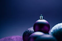 Purple Christmas baubles as festive winter holiday background