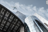 modern building with airplane against a blue sky