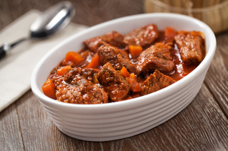 Hot beef stew on a plate. High quality photo.
