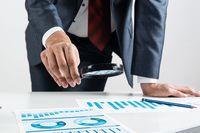 Businessman analyzing financial documents at desk