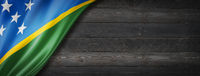 Solomon Islands flag on black wood wall banner