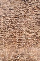 Brown and black brick wall. Close-up