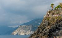 Village of Manarola with colourful houses at the edge of the cliff Riomaggiore, Cinque Terre, Liguria, Italy