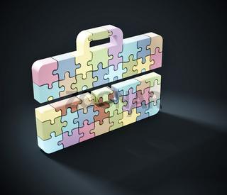 Multi colored puzzle pieces forming briefcase icon. 3D illustration