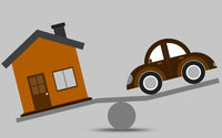 Balance concept of a house and a car