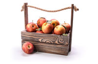apples in a wooden box on a white background with soft shadow