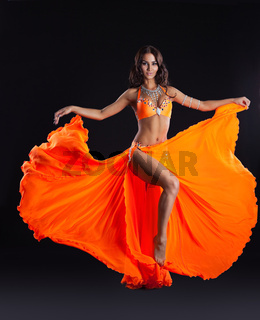 beauty dancer posing in orange veil - arabia style
