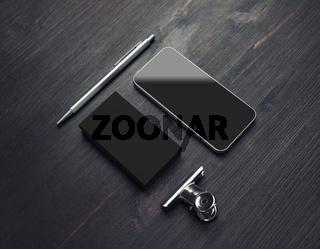 Business card, smartphone, pen