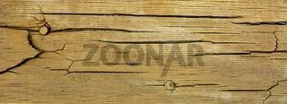 Cracks on a wooden plank