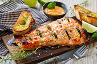 Salmon fillet on cedar wood plank