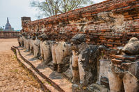 Elephant sculptures at ruins of buddhist temple in Ayutthaya, Thailand