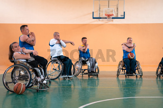 teams of basketball teams with disabilities warm up and do stretching exercises before training begins