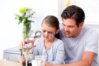 Attentive father and his daughter having breakfast together