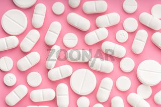 Medicine pills on pink background. Top view