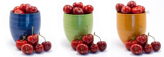 Juicy ruby red cherries in blue, green and orange