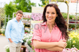 Smiling woman standing at garden center