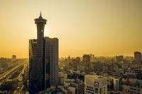 sunset cityscape with skyscraper