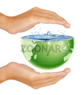 Hands around half earth globe with water splashing