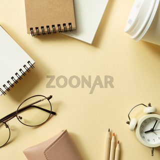 Various office supplies on beige background. workspace. flat lay, top view, copy space