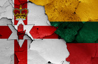 flags of Northern Ireland and Lithuania painted on cracked wall