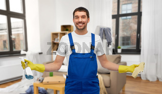 male cleaner with rag and detergent cleaning home