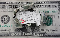 Torn dollar and calendar with May 17th 2021 circled in red, the IRS deadline to pay taxes for 2021