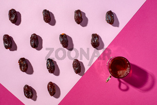 Glass of black tea and date fruit.