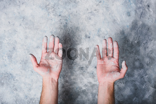Man hands covered with paint
