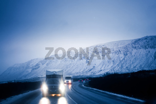 Snow-covered mountains and a car Iceland