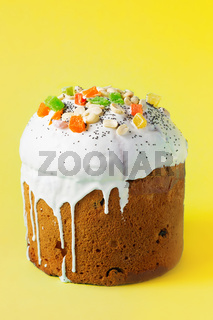 Easter Cake - Russian and Ukrainian Traditional Kulich on a bright yellow background. Paska Easter Bread. Happy easter. Kulich cake symbol of Traditional Orthodox Easter