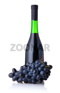 Bottle of red wine with bunch of grapes isolated on white