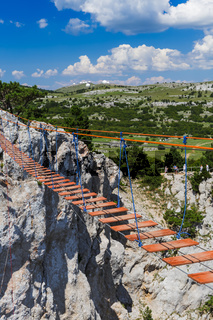 Suspension rope ladder in mountains over the chasm