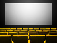 Cinema movie theatre with yellow seats and a blank white screen