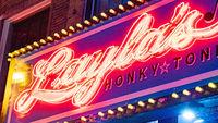 Colorful neon signs on Nashville Broadway at night - NASHVILLE, USA - JUNE 15, 2019