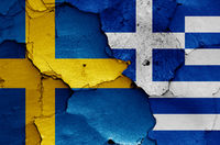 flags of Sweden and Greece painted on cracked wall