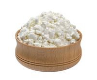 Wooden bowl of cottage cheese isolated on white background