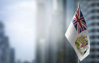 A small flag of British Antarctic Territory on the background of a blurred background