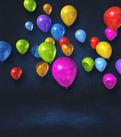 Colorful balloons group on a black wall background