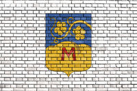 flag of Monor, Hungary painted on brick wall
