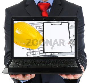 Businessman holding an open laptop