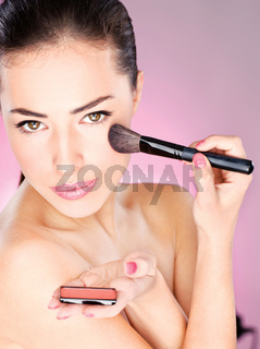 woman and cosmetic brush