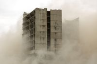 Building demolition by controlled implosion