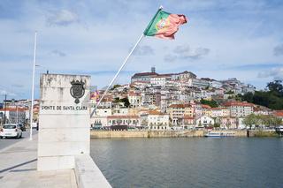 Coimbra city view with Portuguese flag from Santa Clara Bridge, Portugal